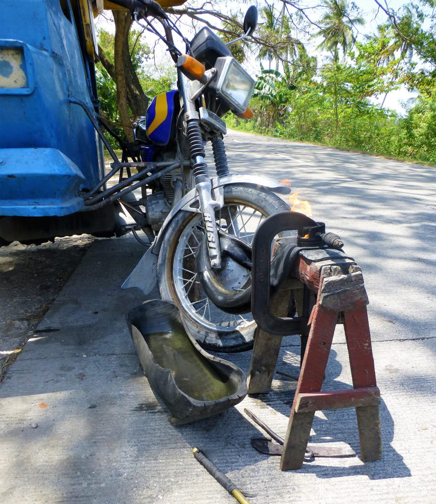 Having a flat tire with your tricycle, Moalboal - Phillipines