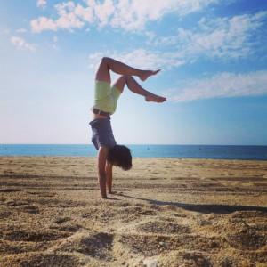Handstand on the beach of Lloret de Mar, Spain