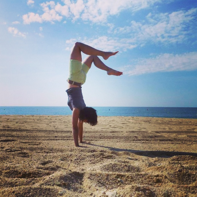 Handstand on the beach of Lloret de Mar, Spain