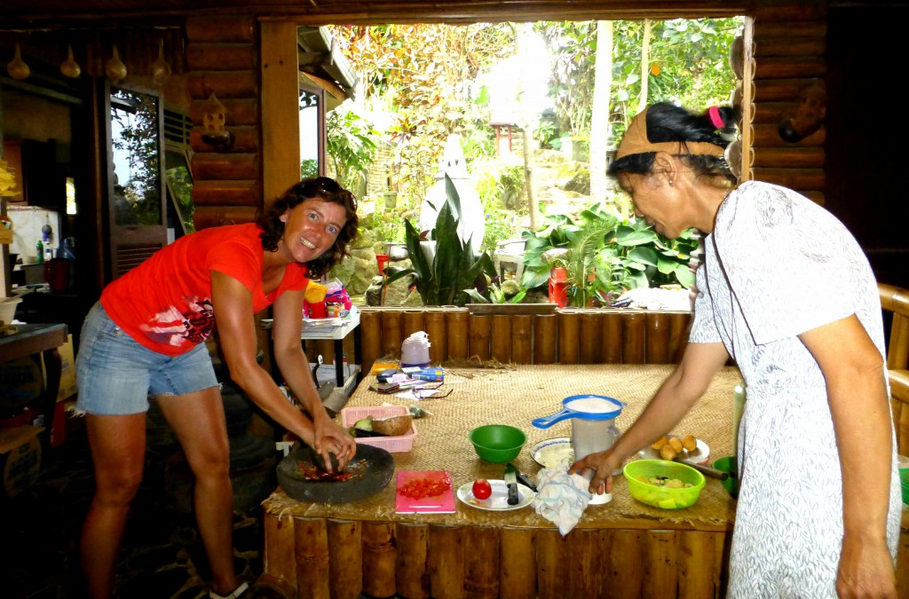 Pounding the peppers - Cooking class at Juwita's Cafe