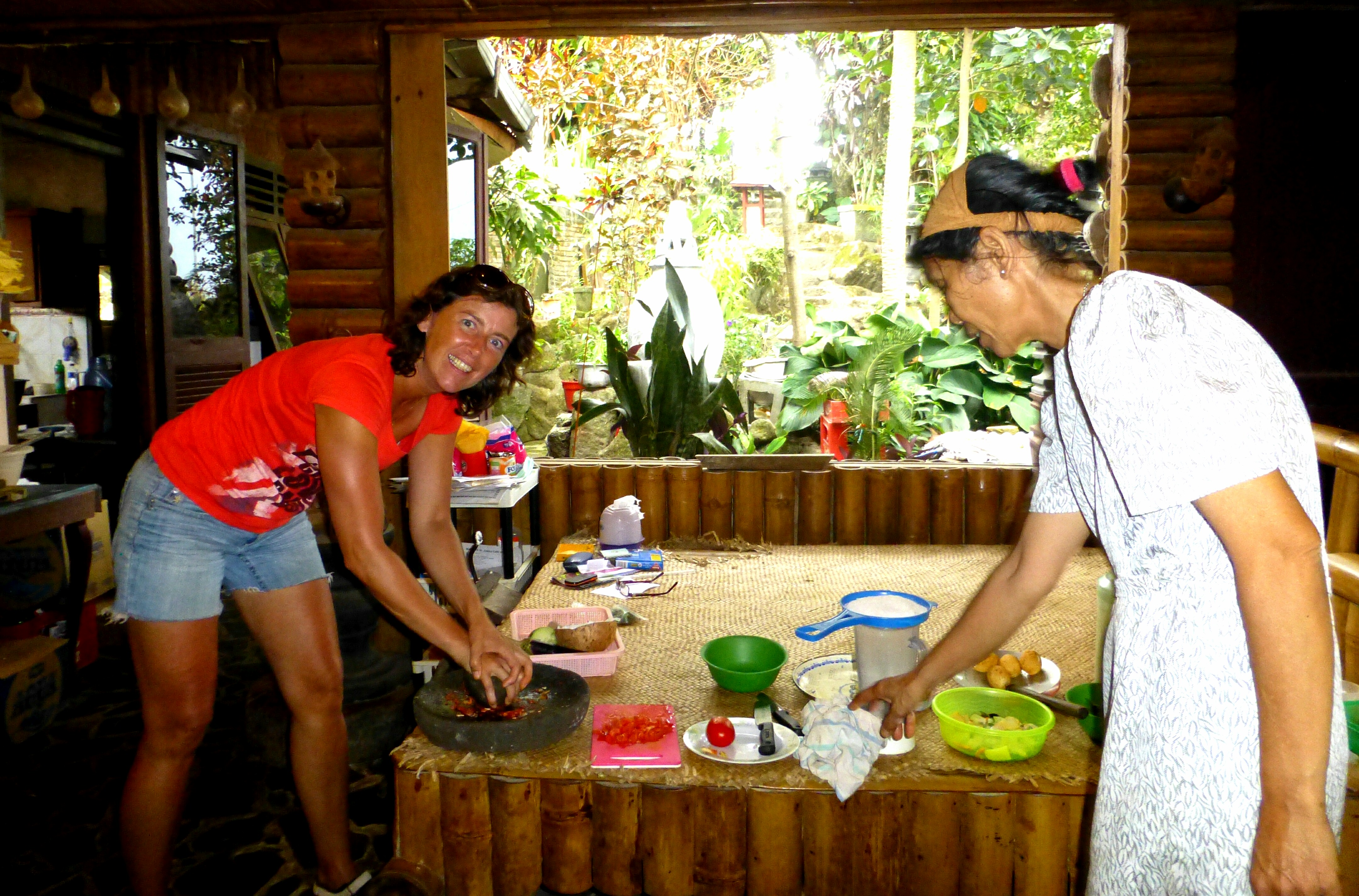 Pounding the peppers - Cooking Class Juwita's Cafe